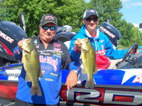 Chad Brauer and Denny Brauer, 1998 Bass Masters Classic Champion, holding their fish